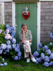 Writer Kurt Vonnegut sits among his beloved hydrangeas