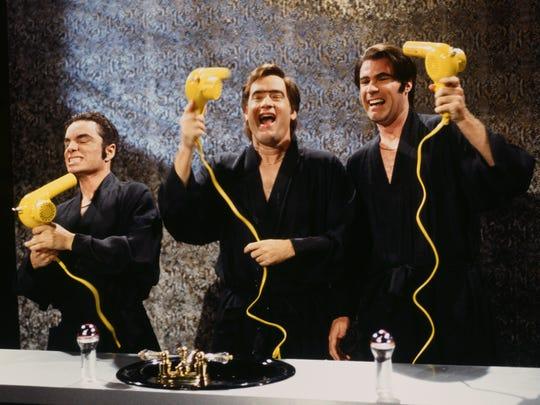 "SNL 40TH ANNIVERSARY SPECIAL -- Season 22, Episode 1 -- Pictured: (l-r) Chris Kattan as Doug Butabi, Tom Hanks as barhop, Will Ferrell as Steve Butabi during the ""Rooxbury Guys"" skit on September 28, 1996 -- (Photo by: Mary Ellen Matthews/NBC)"