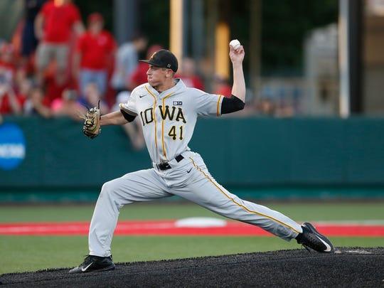 Iowa Hawkeyes pitcher Ryan Erickson (41) delivers the