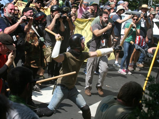 Counter protesters and Alt Right demonstrators clash as they leave Emancipation Park at the Unite The Right Rally held in downtown Charlottesville on Saturday, August 12, 2017.