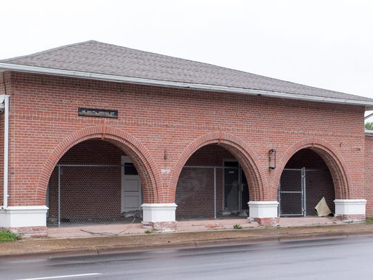 The old USO building, with its iconic arches, at 25