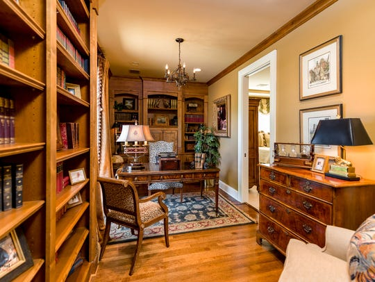 A stately study leads homeowners to the master retreat