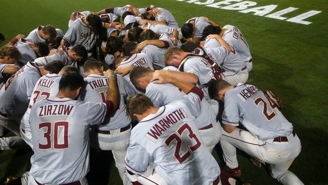 FSU's players huddle up after defeating Florida 3-0 during Game 1 of their NCAA Super Regional against Florida at Alfred A. McKethan Stadium on Saturday.