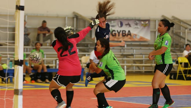 Quality Distributors' Paige Surber scores off a header against Bank of Guam Lady Strykers in a semifinal match of the 2017 Bud Light Women's Futsal League Sunday, Aug. 6, 2017 at the Guam Sports Complex gym in Harmon. Quality Distributors advanced to the championship match with a 9-3 win over the Lady Strykers.