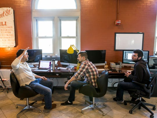 Alex Kaplan (left), Gregory Truono (center) and Sam Molloy (right) work in The Kitchen's office space at the Wilmington train station on Tuesday afternoon.