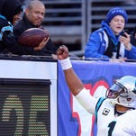 Carolina quarterback Cam Newton (1) gives a ball to a fan after a touchdown this season.