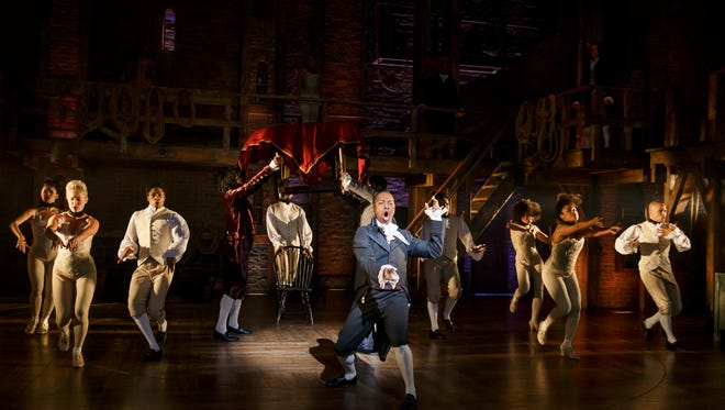 Tony Award nominee Leslie Odom Jr. as Aaron Burr, center, leads the cast in a number from the Broadway production of 'Hamilton.'