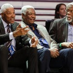 Julius Erving, Oscar Robinson and Bill Russell, from left, talk during the NBA All-Star Saturday Slam Dunk event Saturday, Feb. 14, 2015, in New York. (AP Photo/Frank Franklin II)