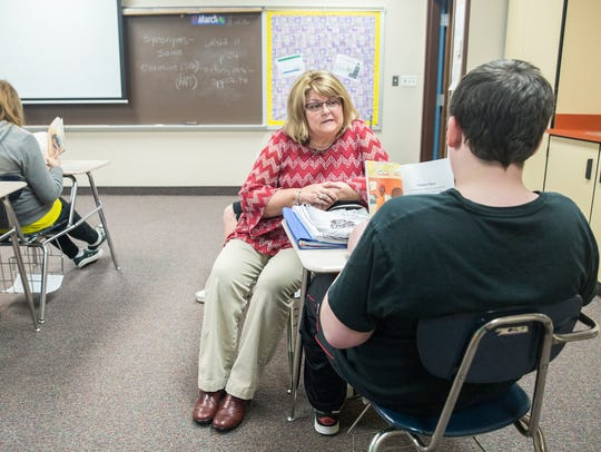Teresa Orcutt works with students at Delta Middle School