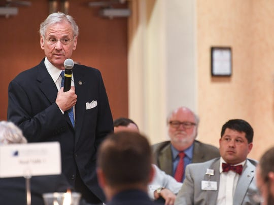 Gov. Henry McMaster responds to a question from Tim Self, right, executive director of the AnMed Health Foundation, during an Anderson Area Chamber of Commerce luncheon at the Hilton Garden Inn in Anderson on Monday.