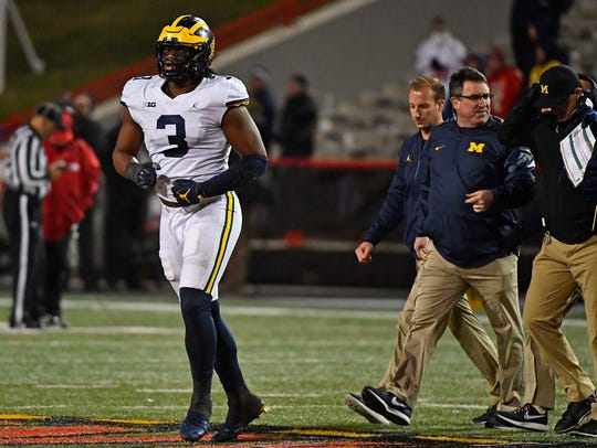 Rashan Gary leaves the field after suffering an apparent arm injury in the second half Saturday.