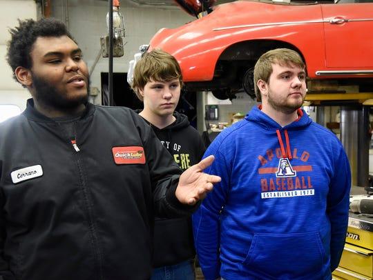Apollo High School students Cerrano Moore, Ethan Beier