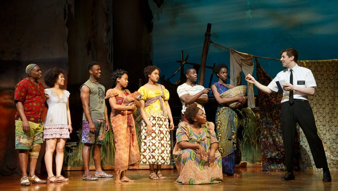 """A missionary preaches to African villagers in Broadway's """"The Book of Mormon."""""""