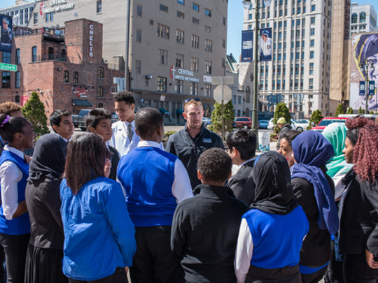 IndyCar driver Charlie Kimball talks to Detroit students outside of Comerica Park on a recent visit to Detroit.
