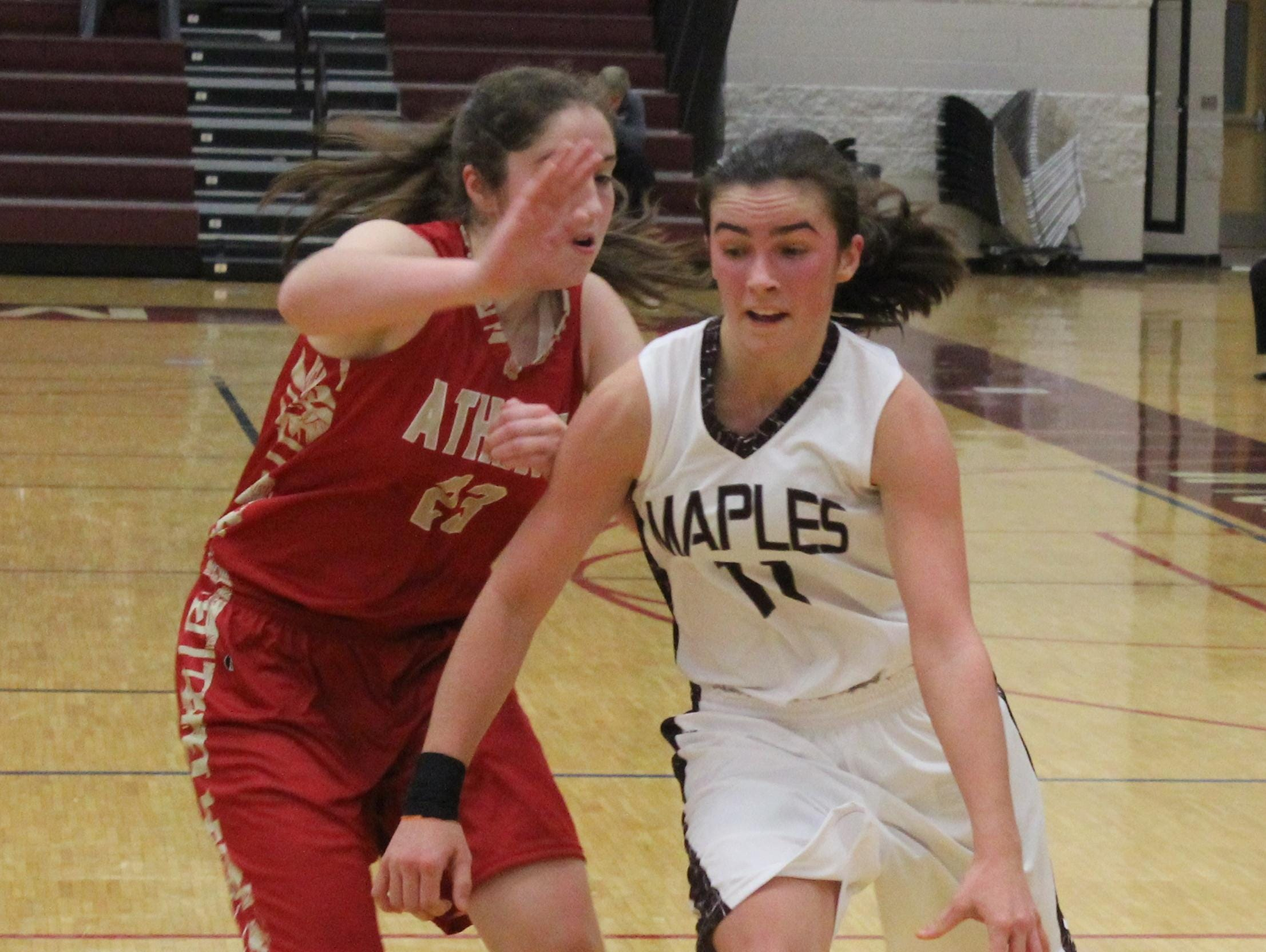 Seaholm's junior guard Mackenzie Harbort races past an Athens defender en route to a game-high 23 points Tuesday evening. The Maples won their season opener, 62-46.