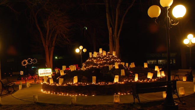 Carrizozo's Spider Park (McDonald) sparkles one Christmas Eve with the luminarias, once placed over most of the town. This Christmas Eve the lumiarias will only be prepared to be placed in front of local churches.