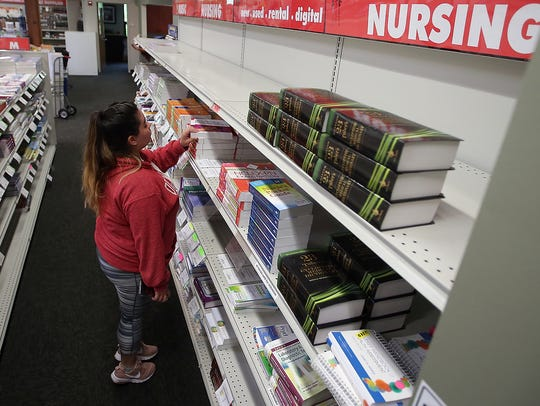 Nursing student Liviert Gasca shops at the Olympic College bookstore in Bremerton on Wednesday. College officials believe that Barnes and Noble could operate the college's bookstore more efficiently and offer students better prices.