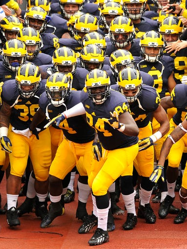 Michigan's football team begins spring practice this