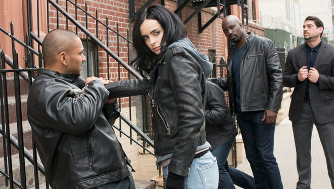 """Jessica Jones (Krysten Ritter)  and Luke Cage (Mike Colter) clean up the streets of New York in """"Marvel's Jessica Jones."""""""