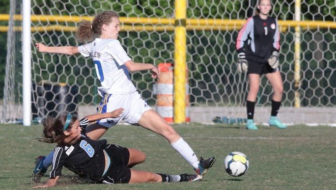 Eastside's Grace Anderson (20) battles for possession with a Chapin player during Eastside's 1-0 loss to Chapin in their Class AAA third-round playoff game Friday night.