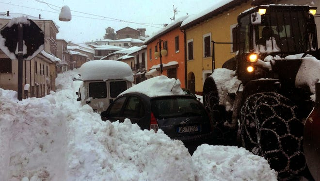 Exceptional snow clogs the roads in Montereale, central Italy, Wednesday, Jan. 18, 2017. Three strong earthquakes shook central Italy in the space of an hour Wednesday, striking the same region that suffered a series of deadly quakes last year and further isolating towns that have been buried under three feet of snow for days. The first tremor, with a preliminary magnitude of 5.3, hit Montereale at about 10:25 a.m. (0925 GMT). (Claudio Lattanzio/ANSA via AP) ORG XMIT: XDS101