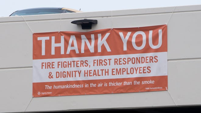 """A """"thank you"""" banner for firefighters, first responders and hospital workers hangs outside Mercy Medical Center in Redding."""