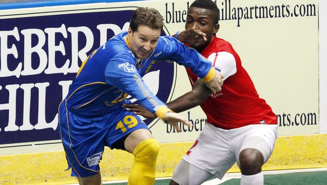 Rochester's Doug Miller, left, gets past Missouri's Robert Palmer during MISL soccer action between the Missouri Comets and the Rochester Lancers at the Blue Cross Arena in Rochester January 1, 2014.