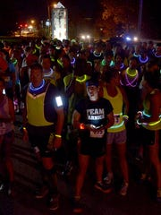 Runners prepare for the 2015 Leadership Jackson Impact Glow Run benefiting the Boys and Girls Club of Jackson Thursday evening at Liberty Garden.
