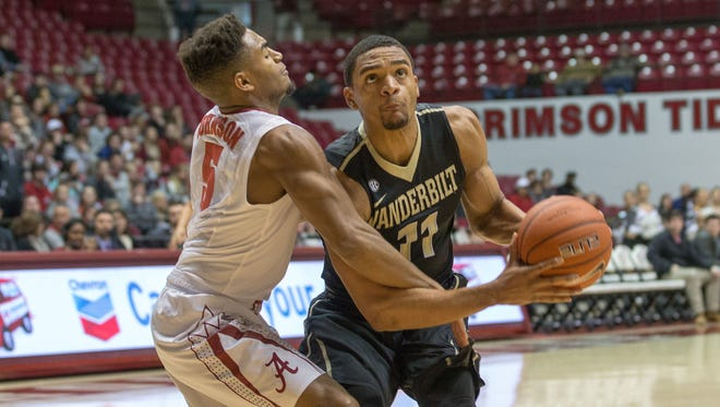 Vanderbilt Commodores forward Jeff Roberson (11) goes to the basket against Alabama Crimson Tide guard Avery Johnson Jr. (5)  on Jan. 7, 2017.