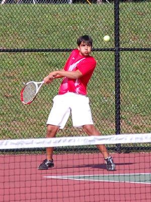 Focusing on his return shot is Canton No. 1 singles player Rohan Vaishnav.