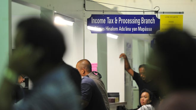 Residents are assisted at the Department of Revenue and Taxation's income tax counter  in this April 2011 file photo.