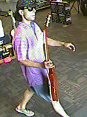 Police say this man walked out of Guitar Center with a stolen Gibson Les Paul Saturday. Do you know him?