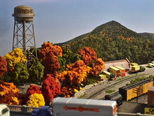 A freight train is shown passing under Route 9W in Highland in David Todd Magill's basement display.