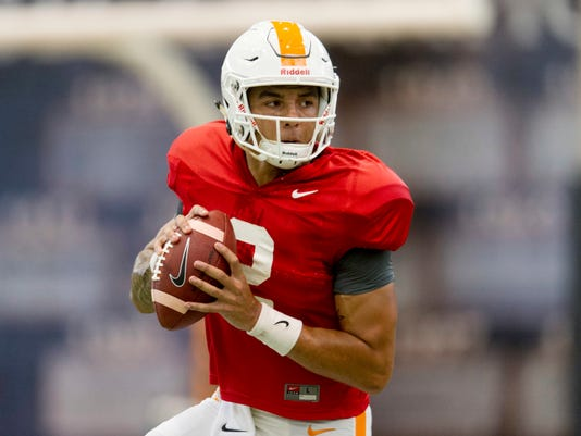 """FILE - In this Tuesday, April 18, 2017, file photo, Tennessee quarterback Jarrett Guarantano (2) participates in the team's spring practice in Knoxville, Tenn. Head coach Butch Jones says he has a """"pretty good idea"""" which of his quarterbacks will start Monday's season opener with Georgia Tech, but he doesn't want to announce his choice.(Calvin Mattheis/Knoxville News Sentinel via AP, File)"""