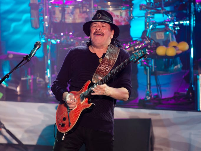 Carlos Santana thrills the audience with his music during his concert at the Ryman Auditorium on April 23, 2014.