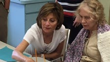 Volunteer Cathy Johnson shown here working with an Alzheimer's patient at a day program in Stuart.