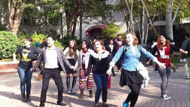 """Students sing and dance to the tune of Michael Jackson's """"Thriller"""" as part of a flash mob at Northeastern University."""
