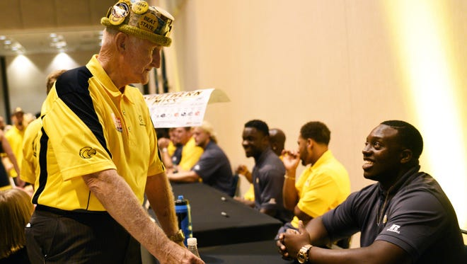 Ray Crawford speaks with Southern Miss football player Johntre' Goudy at Eagle Fanfare on Saturday at Lake Terrace Convention Center.