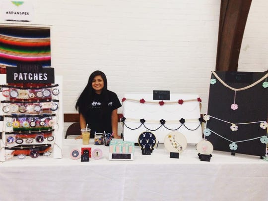 Artist Mikayla Hernandez sells her work at the 2016