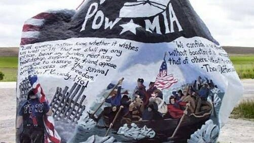 """An example of a painted Freedom Rock by Ray """"Bubba"""" Sorenson. Sorenson has travels the state to paint large (approximately 60 ton) boulders as a thank you to the veterans to honor their service to the country and is scheduled to be in Poweshiek County in August."""