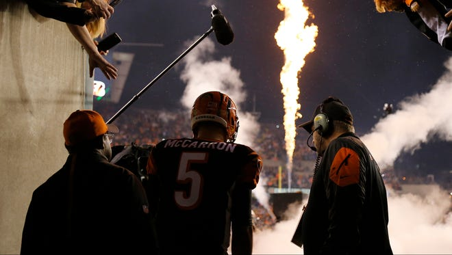Bengals quarterback AJ McCarron waits to take the field as he's introduced before the playoff game between the Bengals and the Steelers at Paul Brown Stadium.
