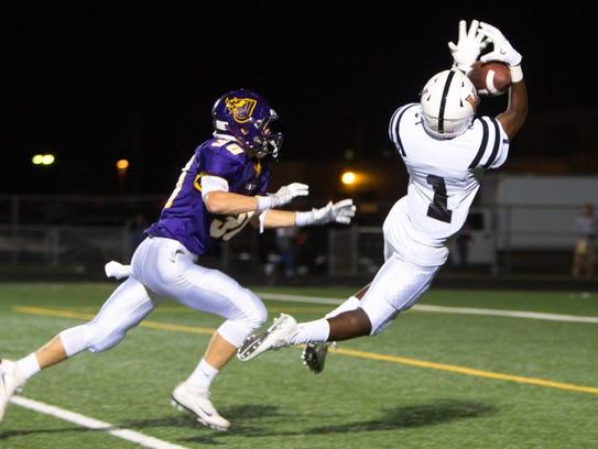 Valley High School's Tariq Brown (1) grabs a touchdown