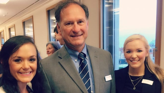 Chelsea Carroll, a 2010 Teurlings graduate, participated in a summer law program in Germany. Carroll, left, is seen with U.S. Supreme Court Justice Samuel Alito and fellow student Kirsten Smith.