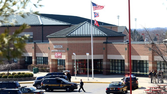 Butler County Sheriff deputies search the school after a 14-year-old boy shot two other students in the cafeteria of Madison Jr/Sr High School.