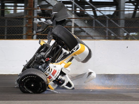 Josef Newgarden (21) of CHF Racing slides in his car