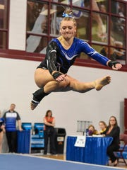 Sartell's Brenna Chisholm does her floor exercise routine