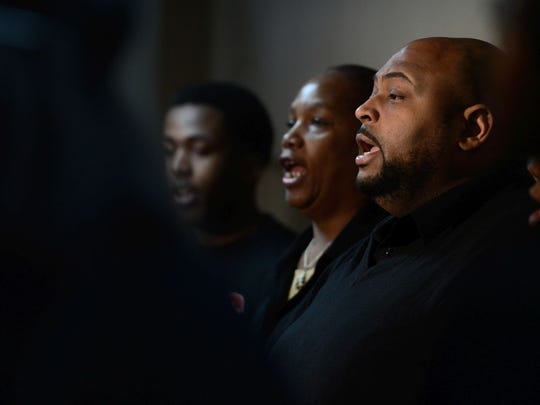 Chris Kimbrough performs with the rest of Divine Temple Church's Choir at the 20th Annual Community Celebration of Dr. Martin Luther King Jr.'s Birthday on Saturday at Northeast Wisconsin Technical College.