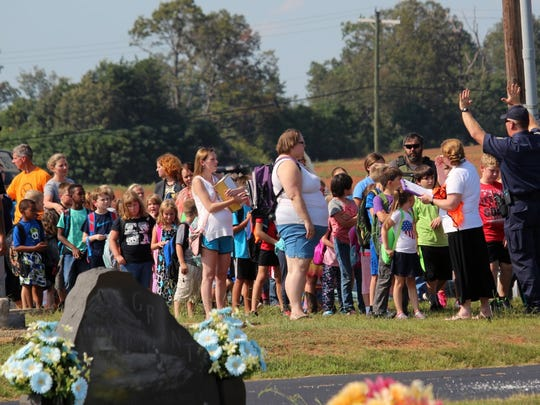 Students are led toward Oakdale Baptist Church after a shooting Wednesday afternoon at Townville Elementary School.