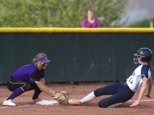 Spanish Springs' Hunter Travers (9) tags out Shadow Ridge's Merisa Osborn during the NIAA softball state championships at Bishop Manogue in Reno on May 17, 2018.