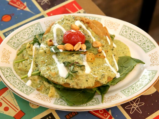 Enchiladas verdes at Sabrosa is a dish the chef previously made at Taqueria Azteca: chicken enchiladas topped with creamy peanut-poblano sauce.